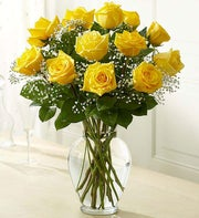long stem yellow roses in clear vase