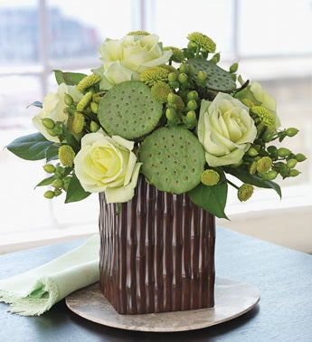lotus pod bouquet in bamboo grove vase