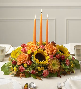 seasonal centerpiece with sunflowers, carnations