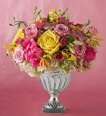 bright mixed arrangement in silver vase
