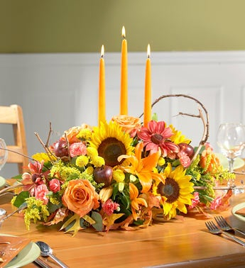 carnations, sunflowers centerpiece w/candles
